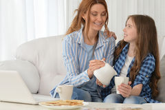 Mother and daughter  with laptop Royalty Free Stock Photos