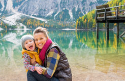 Mother and daughter laughing cheek to cheek on Lake Bries Stock Photography
