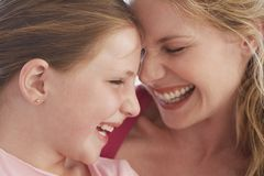 Mother And Daughter Laughing Together Stock Photo