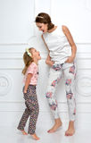 Mother daughter laughing together hugging smiling yelling scream Royalty Free Stock Photos