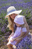 Mother with daughter in lavender field Royalty Free Stock Photo