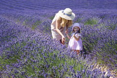 Mother with daughter in lavender field Stock Photo