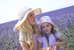 Mother with daughter in lavender field Stock Photography