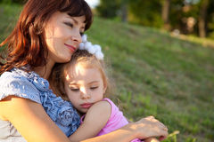 Mother and daughter lay on the grass. Mother and little daughter lay on the grass Royalty Free Stock Photos