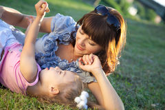 Mother and daughter lay on the grass Royalty Free Stock Photo