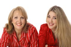 Mother and daughter laying down stock images