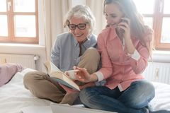 Mother and daughter leading the family business from home stock photos
