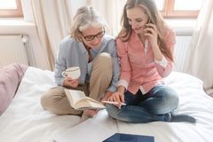 Mother and daughter leading the family business from home royalty free stock photography