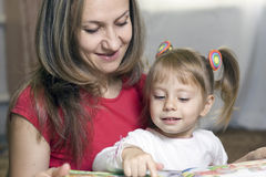 Mother And Daughter Learning At Home Royalty Free Stock Photos