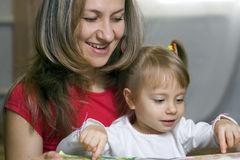 Mother And Daughter Learning At Home Stock Photo