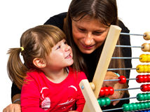 Mother and  daughter learning math with abacus Royalty Free Stock Photos