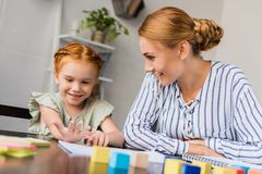 Mother and daughter learning math at home Stock Image