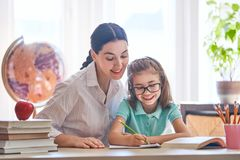 Mother and daughter are learning to write Stock Photos