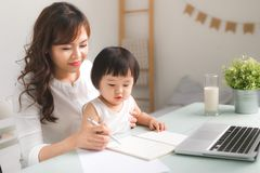 Mother and daughter are learning to write. Mother and daughter are learning to write Royalty Free Stock Photography