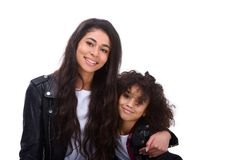 Mother and daughter in leather jackets. Isolated on white Royalty Free Stock Photography