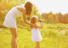 Mother and daughter, leisure. Girl looking in the binoculars Royalty Free Stock Photography