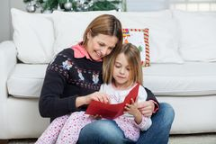 Mother And Daughter With Letter Royalty Free Stock Images