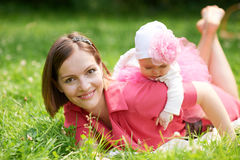 Mother and daughter lie on grass Royalty Free Stock Image