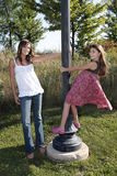 Mother and daughter at light pole Royalty Free Stock Images
