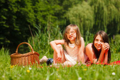 Mother and daughter little girl having picnic in park Stock Image