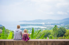 Mother and daughter look around from mountain view point on trop Royalty Free Stock Photos