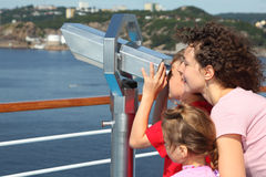 Mother, daughter look through binoculars Stock Image