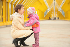 Mother and daughter look each other Stock Photos