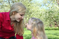 Mother and daughter look on each other Royalty Free Stock Images