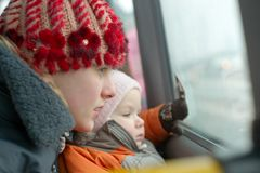 Mother with daughter look to bus window Royalty Free Stock Photos