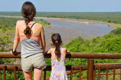 Mother and daughter looking at beautiful river view Royalty Free Stock Photography