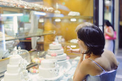 Mother and Daughter Looking at Cakes Stock Photos