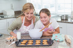 Mother and daughter looking at cookies Stock Photography