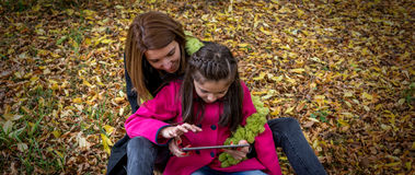 Mother and daughter looking at digital tablet Stock Photography