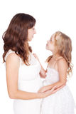 Mother and daughter looking each other in eyes Royalty Free Stock Photography