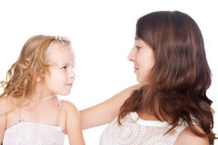 Mother and daughter looking each other in eyes Stock Photos