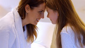Mother and daughter looking each other face to face stock video footage