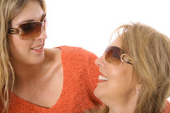 Mother and daughter looking at each other in glass Royalty Free Stock Photos