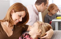 Mother and daughter looking at each other smiling royalty free stock image