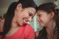 Mother and daughter looking face to face and smiling Royalty Free Stock Photography