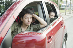Mother and Daughter Looking Frustrated Out the Window of a Car Royalty Free Stock Photo
