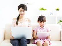 Mother with  daughter looking at Laptop Stock Images