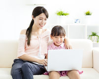 Mother with  daughter looking at Laptop Stock Photo