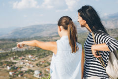 Mother and daughter looking on mountain peak Royalty Free Stock Photography
