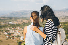 Mother and daughter looking on mountain peak Royalty Free Stock Images