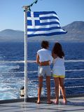 Mother and Daughter Looking Over Stern of Greek Island Ferry Stock Photography