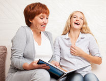 Mother and daughter looking photo book Royalty Free Stock Images