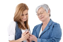 Mother and daughter looking at photos on mobile Royalty Free Stock Image