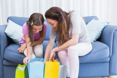 Mother and daughter looking at shopping bags Royalty Free Stock Photos