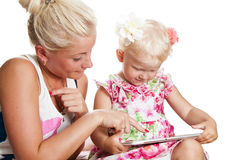 Mother and daughter looking tablet Stock Images