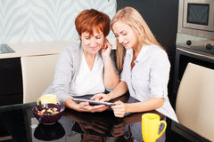 Mother and daughter looking in tablet pc Royalty Free Stock Photography